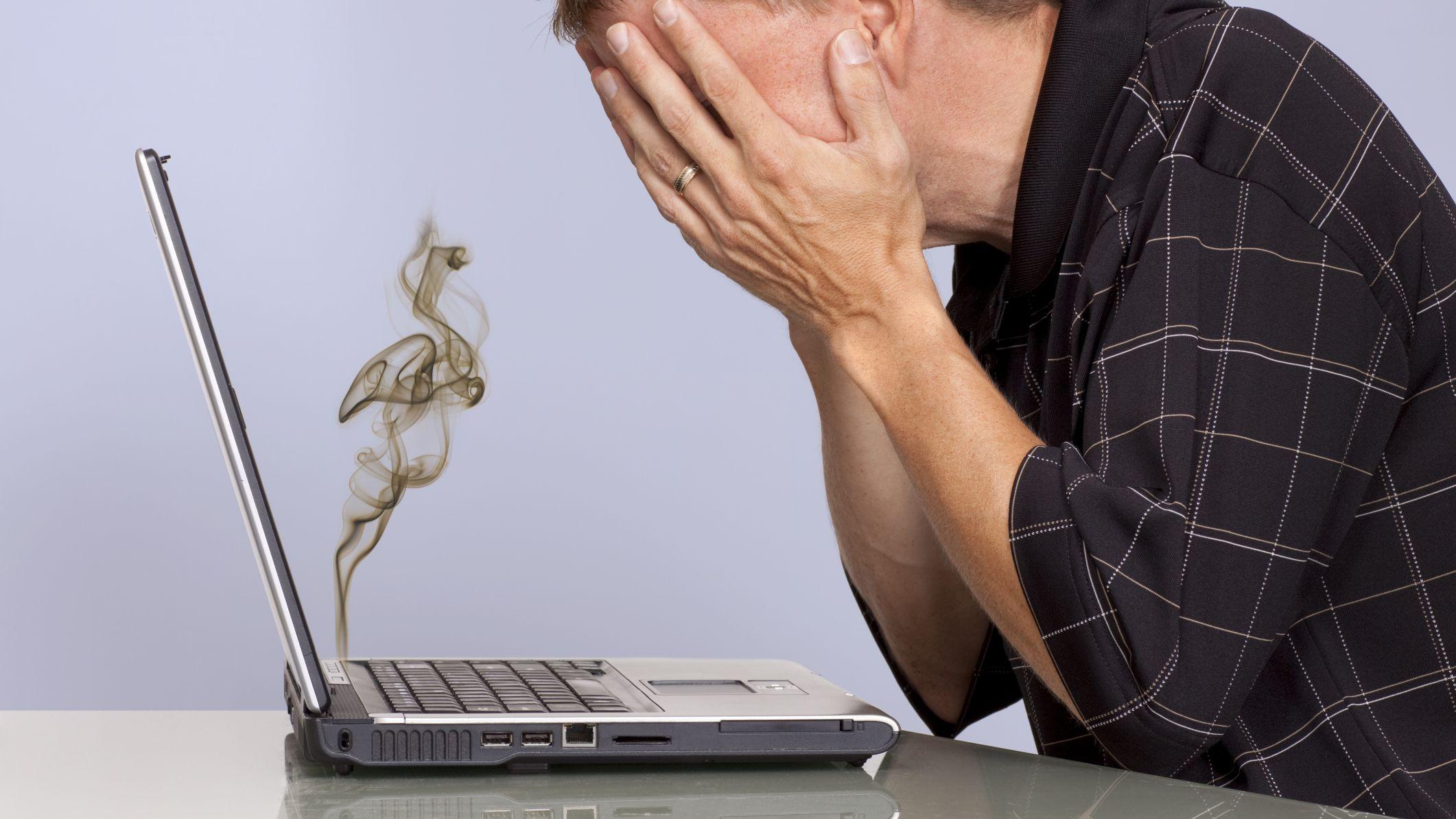 Getty-John-Cowie-Man-with-crashed-smoking-laptop-186845374-56a2f15f5f9b58b7d0cfd532.jpg