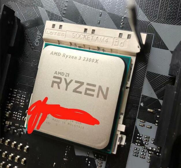 First Benchmarks, Photo of AMD's Ryzen 3 2300X Surface
